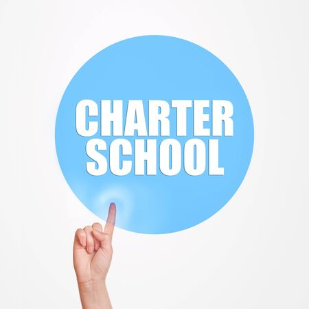 charter: Charter school concept, hand pushing virtual button of internet page to get informed about studies. Stock Photo