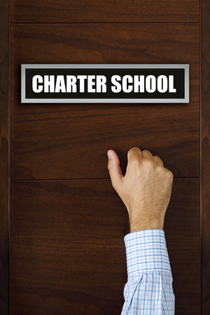 charter: Charter school concept, male hand knocking on the door