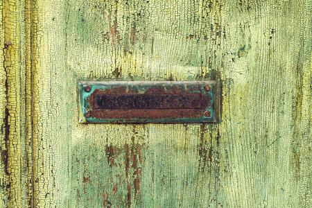 letterbox: Vintage letterbox on wooden door, obsolete rough wooden texture
