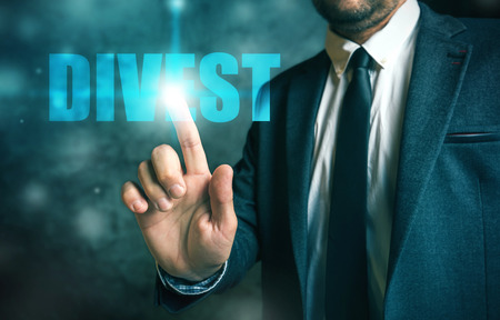 economic: Divestment concept with businessman in suite - finance and economics business theme.