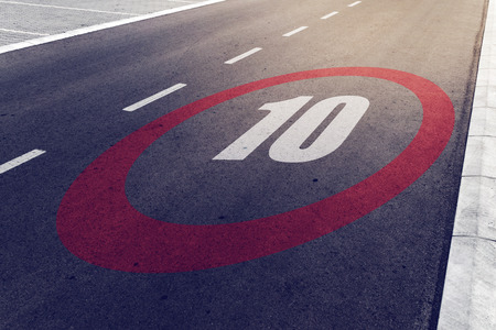 mph: 10 kmph or mph driving speed limit sign on highway, road safety and preventing traffic accident concept.