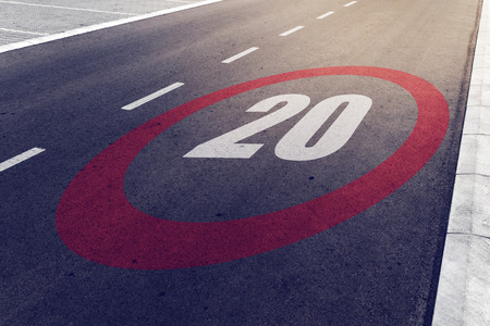 mph: 20 kmph or mph driving speed limit sign on highway, road safety and preventing traffic accident concept.