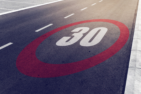 mph: 30 kmph or mph driving speed limit sign on highway, road safety and preventing traffic accident concept.