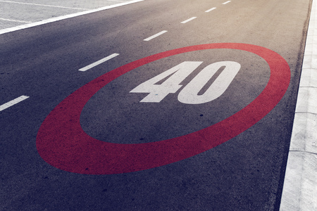 miles: 40 kmph or mph driving speed limit sign on highway, road safety and preventing traffic accident concept. Stock Photo