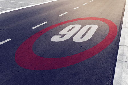 90 kmph or mph driving speed limit sign on highway, road safety and preventing traffic accident concept. Stock Photo - 65401216
