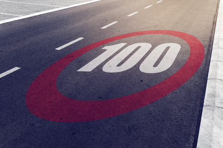 mph: 100 kmph or mph driving speed limit sign on highway, road safety and preventing traffic accident concept.