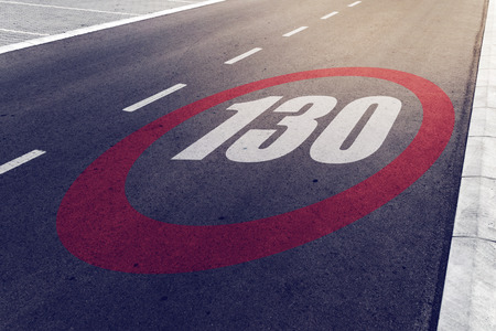 130 kmph or mph driving speed limit sign on highway, road safety and preventing traffic accident concept.
