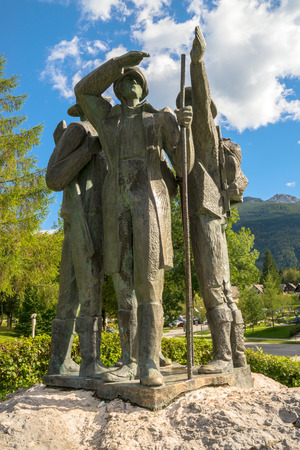 bohinj: RIBCEV LAZ, SLOVENIA - AUGUST 22, 2016: Four brave men from Bohinj - the first men on Triglav. Statue of Bohinj natives that climbed highest mountain in Slovenia on August 26th in 1778. Editorial