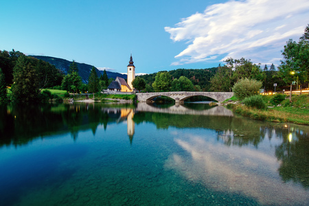 bohinj: BOHINJ LAKE, SLOVENIA - AUGUST 22, 2016: Church of St. John the Baptist at Bohinj Lake is over 700 years old and is a beautiful example of Middle Age architecture and fresco painting in Slovenia.