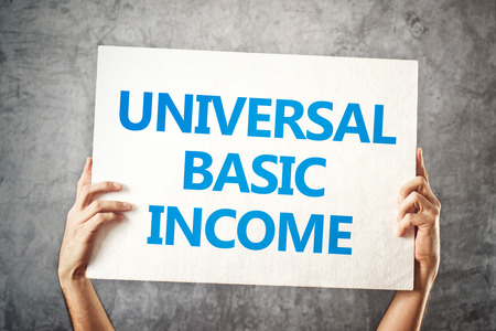 Universal basic income concept with hands holding banner