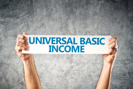 Universal basic income concept with hands holding banner Banco de Imagens - 65406412