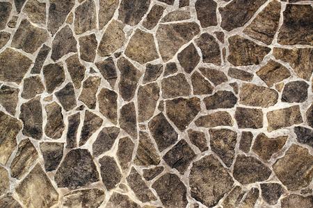 Stonework textuur, abstracte achtergrond van steenmuur of vloeren van rotsen als bouwmateriaal