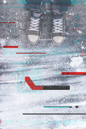 young adult man: Pair of sneakers on pavement with digital glitch effect, young adult man standing on concrete flooring