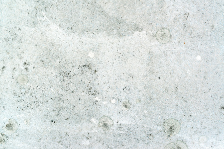 dirt background: Grunge concrete texture, white paint on flooring surface with dirt and stains as abstract background Stock Photo