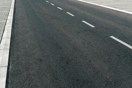 pavement: Empty two lane asphalt road highway vanishing in perspective