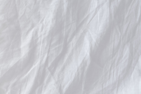 displacement: Top view of creased bedding sheets, texture useful as displacement map