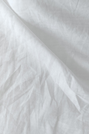 wrinkled: Top view of used bed sheets, crumpled bedding texture Stock Photo