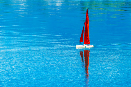 simulation: Radio remote control rc sailing yacht boat simulation model in blue water