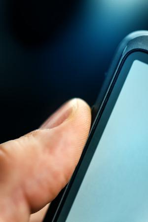 unlocking: Unlocking smart phone with fingerprint sensor scan, close up with selective focus Stock Photo