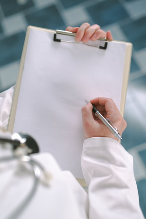 pharmacologist: Female doctor in white uniform writing on clipboard paper as copy space for patients medical history or medicine prescription. Woman as health specialist in exam, er, disease prevention, visit check or healthcare lifestyle concept