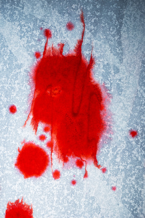 Blood stains on white paper, abstract background for violence, murder or crime scene