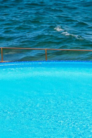 poolside: Poolside by the sea, water surface texture