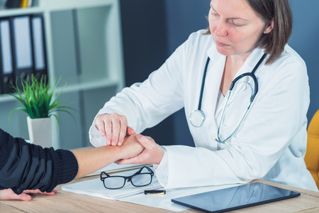 disjoint: Female patient at orthopedic medical exam in doctors hospital office, traumatology and medical consultation for hand wrist injury Stock Photo