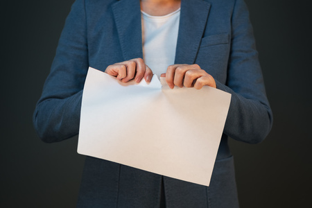 tearing: Unsatisfied and angry businesswoman tearing business legal agreement contract paper