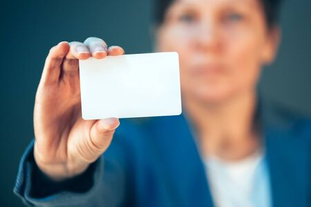 Businesswoman holding blank business card as copy space for text or career motivational message Stock Photo