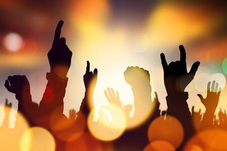 stage performance: Music concert crowd hands raised in air during live performance on stage, abstract illustration Stock Photo