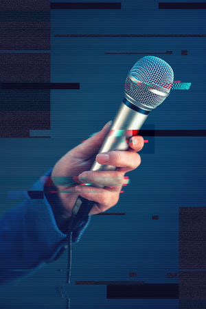 hand press: Female journalist conducting business interview or press conference, hand with microphone, digital glitch effect Stock Photo