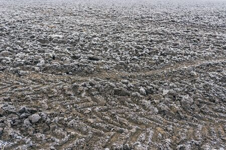 snow field: Frozen plowed agricultural field covered with frost in early winter morning Stock Photo