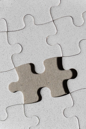 missing piece: Blank white jigsaw puzzle and missing piece as copy space