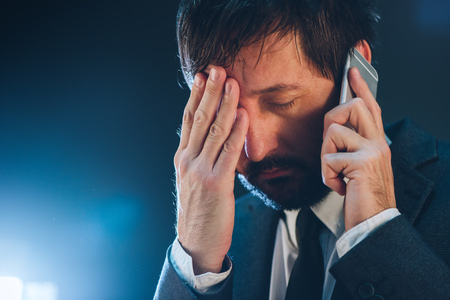 phone calls: Late night business phone call with mobile, tired and exhausted businessman having conversation with his superior