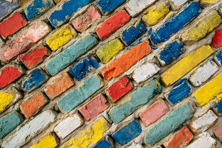bricks background: Multicolored painted bricks, exterior wall as background, urban pattern Stock Photo