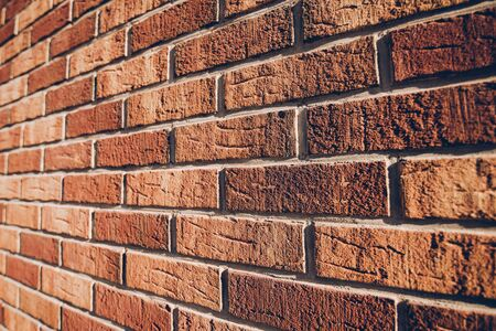 angle: Beautiful rustic brickwork in perspective, brick wall detail with shallow depth of field Stock Photo