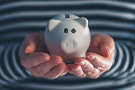 coinbank: Woman with piggy coin bank, home budget, finance and savings concept