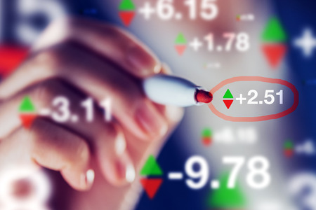 stock exchange: Businesswoman tracking stock market indicators, business trade and economy concept