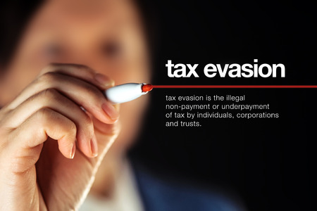 taxpayers: Tax evasion definition, illegal non-payment or underpayment of tax by individuals, corporations and trusts Stock Photo