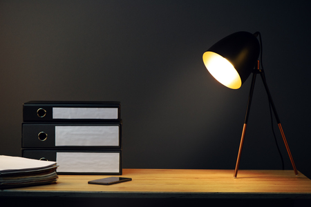 ring binders: Office desk with lamp, ring binders and mobile phone Stock Photo