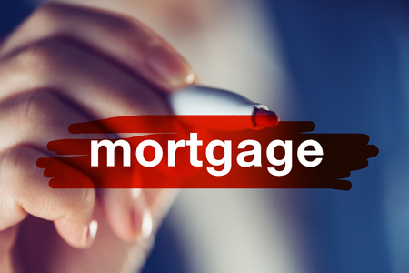 Business mortgage concept, businesswoman highlighting word with red marker pen