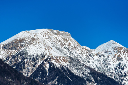 snowcapped: Snowcapped Julian Alps and clear sky behind as copy space Stock Photo