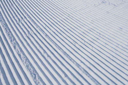 Ski track in snow surface as abstract winter background Stock Photo