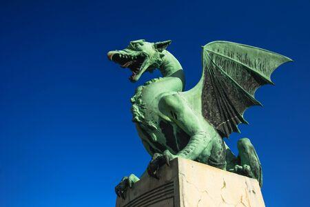 LJUBLJANA, SLOVENIA - FEBRUARY 19, 2017: Statue on Dragon Bridge over Ljubljanica river in Ljubljana, capital of Slovenia. It was originally named The Jubilee Bridge of the Emperor Franz Josef I.