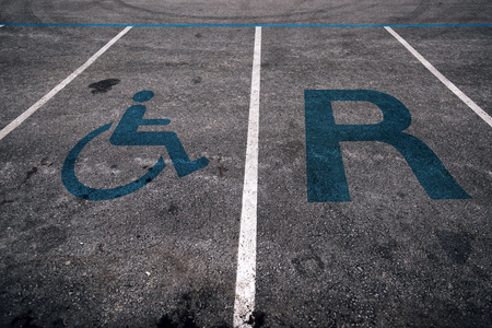 Reserved parking space lot for handicapped person