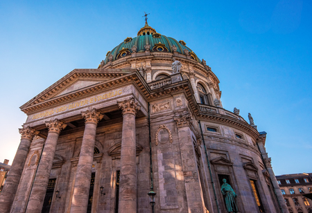 COPENHAGEN, DENMARK - MARCH 11, 2017: Front entrance of the Marble Church (Marmokirken) in Copenhagen, Denmark also known as Frederiks church (Frederiks Kirke), famous for its rococo architecture
