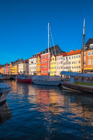 COPENHAGEN, DENMARK - MARCH 11, 2017: Copenhagen Nyhavn canal and promenade with its colorful facades, 17th century waterfront is an entertainment district and famous landmark in Danish capital