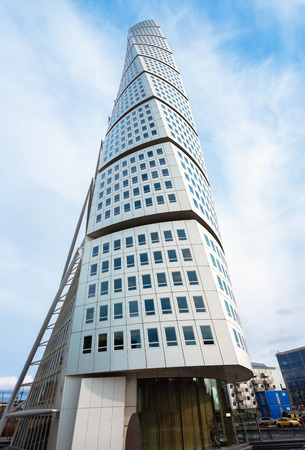 building structures: MALMO, SWEDEN - MARCH 07, 2017: Malmo Turning Torso is built in nine segments twisted relatively to each other, topmost segment is twisted 90 degrees clockwise with respect to the ground floor