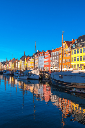 COPENHAGEN, DENMARK - MARCH 11, 2017: Tourists in Copenhagen Nyhavn district. The famous Danish fairytale writer, Hans Christian Andersen, used to live in no. 20 Editorial