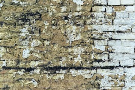 often: Old weathered mudbrick wall texture, mud-brick construction is often adobe Stock Photo